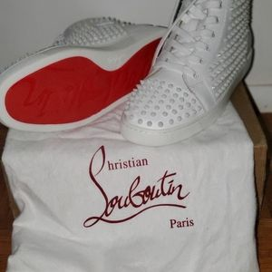 Christian Loubotin sneakers (red bottoms)